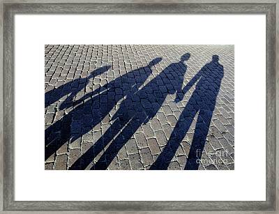 Family Of Four Casting Shadows On Cobbled Stone Street Framed Print by Sami Sarkis
