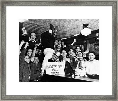 Fans Cheer A Brooklyn Dodgers Pennant Framed Print by Everett