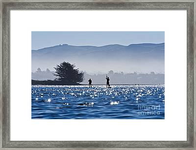 Faraway Paddle Boarders In Morro Bay Framed Print by Bill Brennan - Printscapes