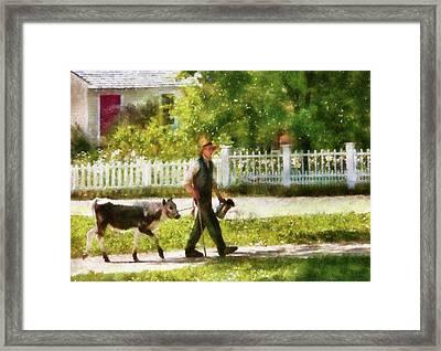 Farm - Cow - Bringing Home Bessie Framed Print by Mike Savad