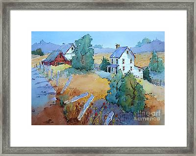 Farm With Blue Roof Tops Framed Print