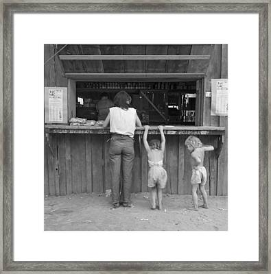 Farm Worker At Company Store Framed Print by Dorothea Lange