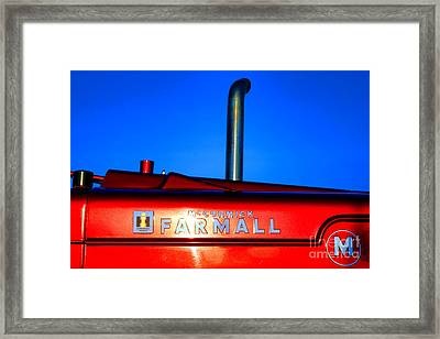 Farmall Sunset Framed Print by Olivier Le Queinec