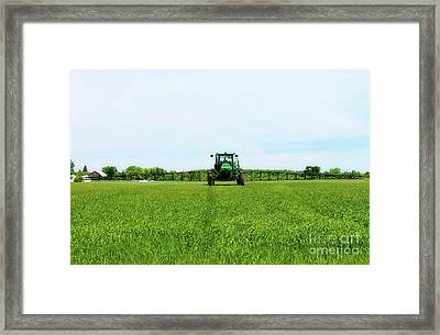 Farmer And Tractor Framed Print by Anthony Djordjevic