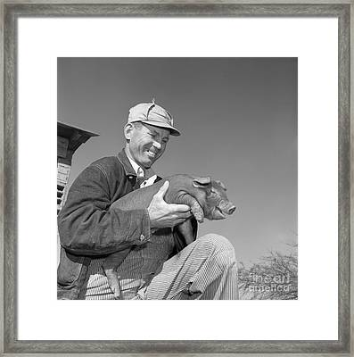 Farmer Holding Piglet, C.1950s Framed Print by B. Taylor/ClassicStock