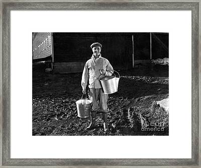 Farmer With Milk Pails C.1930-40s Framed Print by H. Armstrong Roberts/ClassicStock