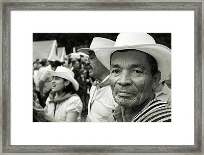 Farmer With Poncho Framed Print