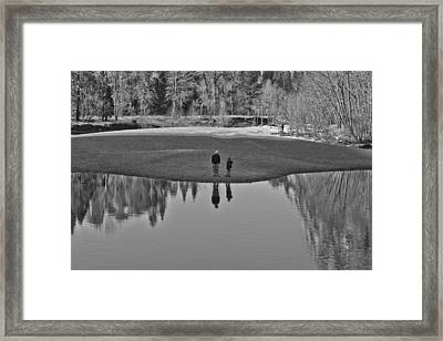 Father And Son Reflected Framed Print
