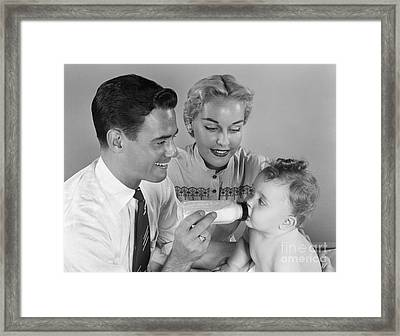 Father Bottle-feeding Baby, C.1950s Framed Print by H. Armstrong Roberts/ClassicStock
