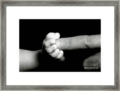 Father's Finger Touching His Baby's Foot Framed Print by Sami Sarkis