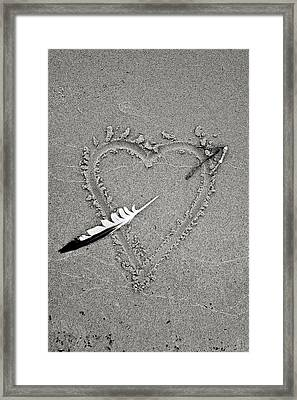 Feather Arrow Through Heart In The Sand Framed Print