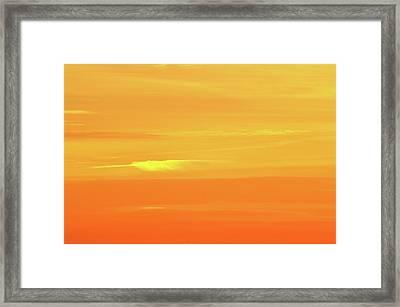 Feather Cloud In An Orange Sky  Framed Print