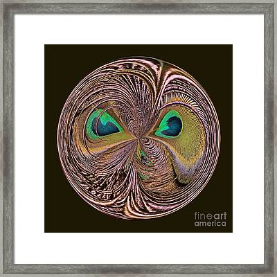 Feather Eyes Orb Framed Print