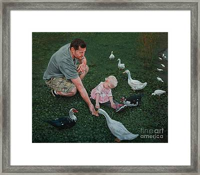 Feeding Ducks With Daddy Framed Print by Michael Nowak