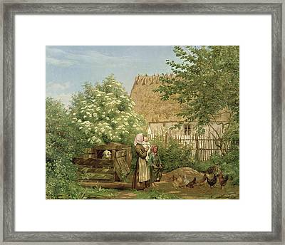 Feeding The Chickens Framed Print by Frederick Christian Lund