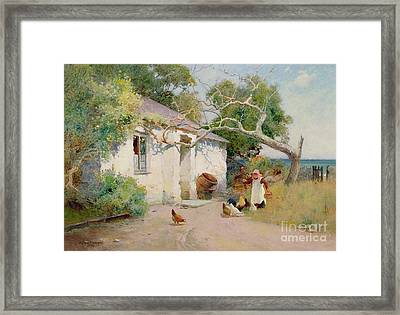 Feeding The Hens Framed Print by Arthur Claude Strachan