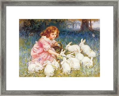 Feeding The Rabbits Framed Print by Frederick Morgan