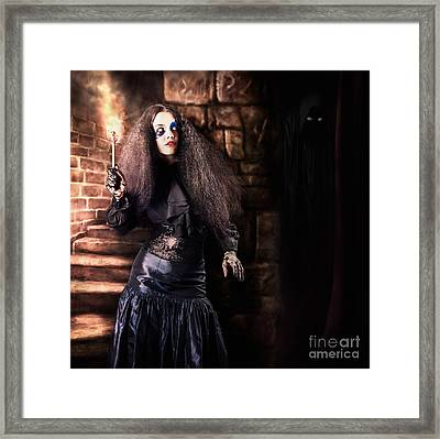 Female Jester Walking Inside Dark Castle Stairwell Framed Print by Jorgo Photography - Wall Art Gallery