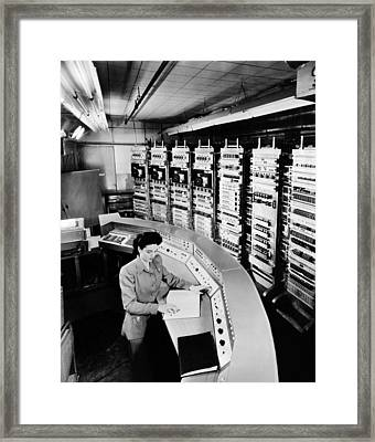 Female Operator At The Console Framed Print by Everett