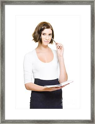 Female Pa Penning Down Work Schedule In Diary Framed Print by Jorgo Photography - Wall Art Gallery