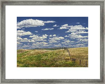 Fence Along The Rolling Hills By The Roadway Framed Print