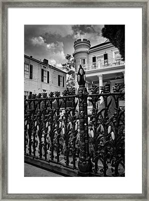 Fence At Cornstalk Hotel In Black And White Framed Print by Chrystal Mimbs