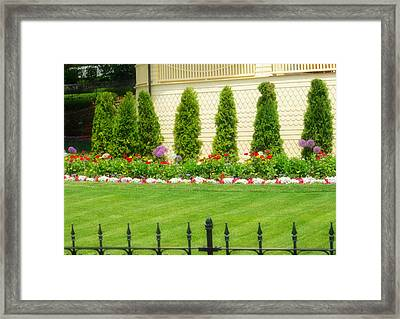 Fence Lined Garden Framed Print by Kendall Tabor