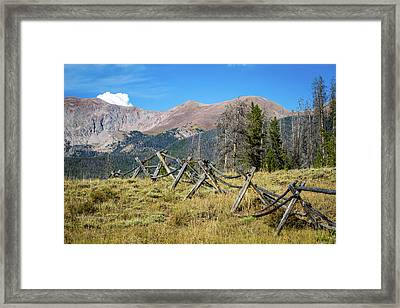 Fences Into The Rockies Framed Print