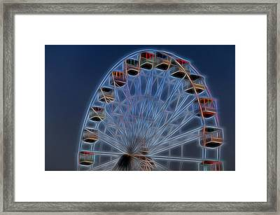 Ferris Wheel Glow Framed Print by Terry DeLuco