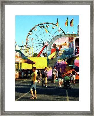 Ferris Wheel In Distance Framed Print by Susan Savad
