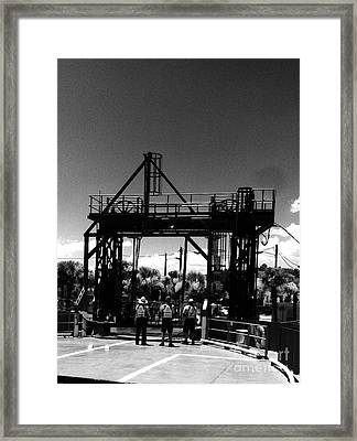 Ferry Workers Framed Print by WaLdEmAr BoRrErO