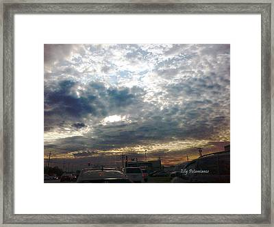 Framed Print featuring the pyrography Fierce Skies by Elly Potamianos