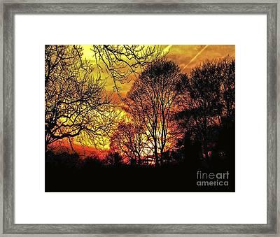 Fiery Red Sunset Framed Print by Carol F Austin