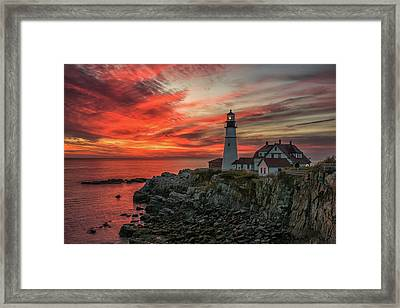 Fiery Sunrise At Portland Head Light Framed Print
