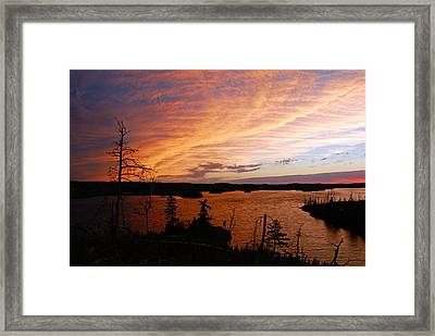 Fiery Sunset Over Seagull Lake Framed Print by Larry Ricker