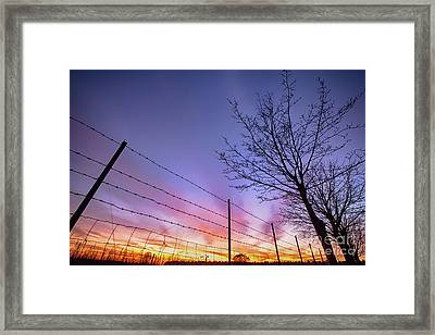 Fiery Norfolk Sunset Viewed Through Barbed Fence Framed Print