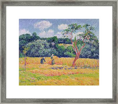 Figures Harvesting A Wheat Field Framed Print by Henry Moret