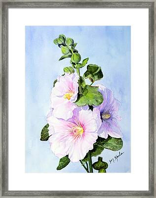 Finally Hollyhocks Framed Print