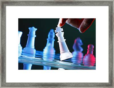 Finger Tilting A Chess Piece On Chess Board Framed Print