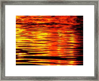 Fire At Night On The Water Framed Print