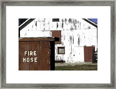Fire Hose Framed Print by Lora Lee Chapman