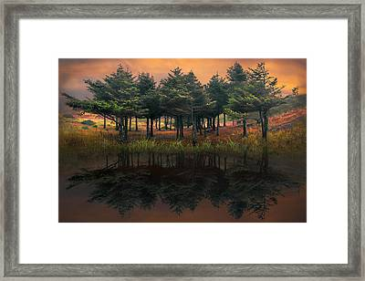 Fire In The Lake Framed Print by Debra and Dave Vanderlaan