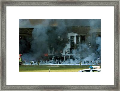 Firefighters Work To Put Out The Flames Framed Print by Everett