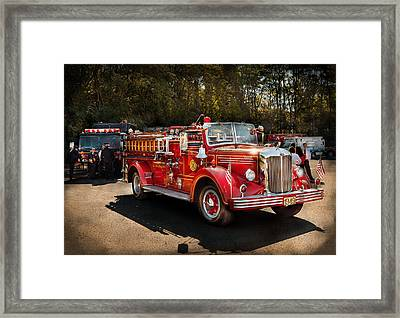 Fireman - The Procession  Framed Print by Mike Savad