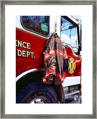Fireman's Jacket On Fire Truck Framed Print by Susan Savad