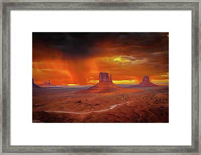 Firestorm Over The Valley Framed Print by Mark Dunton
