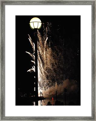 Fireworks Behind The Street Light Framed Print by Gene Sizemore