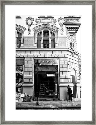 First Shopper Framed Print by John Rizzuto