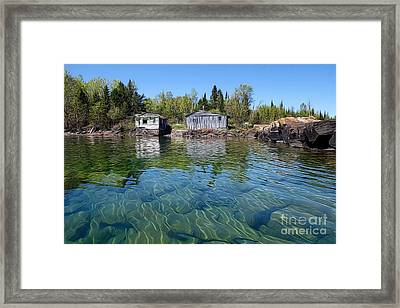 Fish House Reflections On Lake Superior Framed Print by Sandra Updyke