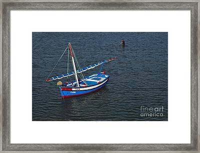 Fisherman And Sailboat Framed Print by Angelo DeVal